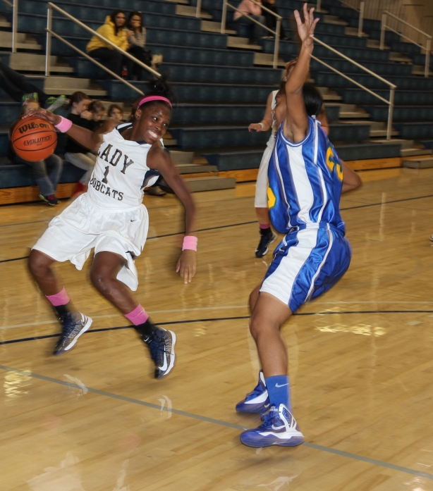Lady Cat guard Kiarra Parks, left, stops on a dime to fly past a Southern Crescent defender Saturday night.
