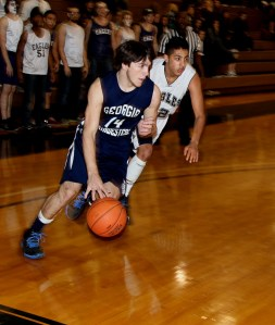 """Freshman Bobcat guard Hunter Ivester (Trion, GA) drives the baseline against the Toccoa Falls College defense Tuesday night in Georgia Northwestern's road loss, 73-70, to the Eagles."""