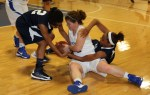 """Freshmen Lady Cats Alana Jones (Rockmart, GA), left, and Mariah Price (Summerville, GA) battle for a loose ball with Covenant College senior Mae Mae Johnson (Montgomery, AL) in Georgia Northwestern's win over the Lady Scots Wednesday, 70-47."""