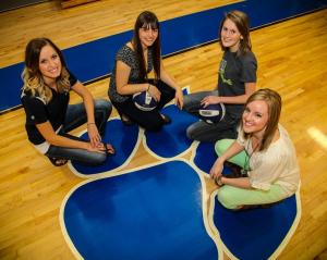 """Posing for a signing day picture on the Ringgold High School (GA) hardwood are, from left, Carrie Powell, Georgia Northwestern Women's Head Volleyball Coach; Rachel McGill, Georgia Northwestern signee; Victoria Sprouse, Georgia Northwestern signee; and Cadi Dotson, Ringgold High School Girls' Volleyball coach."""