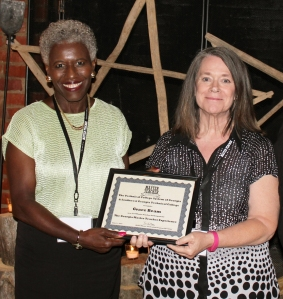 Dr. Josephine Reed-Taylor, deputy commissioner of the Technical College System of Georgia presents Graceful Beam, instructor of Business Management at GNTC, with a certificate for participating in the Georgia Master Teacher Experience.