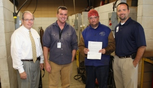 """Pictured, from left, are GNTC President Pete McDonald, GNTC Welding Instructor Jeremiah Cooper, GNTC Welding student and Grainger Scholarship Winner James Dees, and GNTC Vice President of Student Affairs Stuart Phillips."""