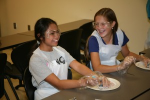 Grace Shultz (Left) and Abby Davis (right) dissect cow eyes as part of the Young Scholars program at GNTC. Both students are rising eighth-graders at Rome Middle School.