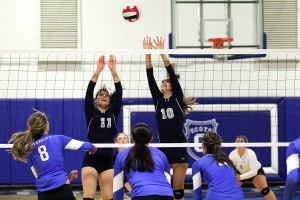 Lady Bobcats Rachel McGill (11) and Erin Hurley (10) go up to attempt a block during Georgia Northwestern's volleyball match against the Covenant College junior varsity squad Monday night on Lookout Mountain.