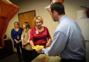 V.P. of Student Affairs at Georgia Northwestern stops by the Walker County Campus to slice and serve some cake to just a few of our many dedicated financial aid workers at GNTC in honor of Financial Aid Appreciation Day at the college!