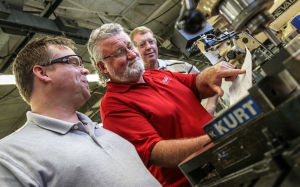 """""""NIMS specialist Mike Blizzard, center, shows a project design to Savannah Technical College Machine Tool Technology instructor Jeffrey Friend, left, and Georgia Northwestern Technical College Machine Tool Technology instructor Philip Shirley during a NIMS training visit at GNTC earlier this month."""""""