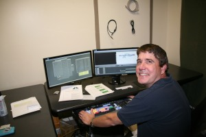 John Kenyon, media specialist at GNTC, edits a video project at GNTC's production studios on the Floyd County Campus. Kenyon recently won two Medallion Awards for his video production work, as well as an additional Medallion Award for a feature article he wrote about GNTC's Residential Energy Efficiency Technology program.