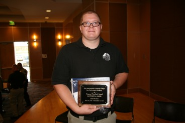 "Matthew A. Hicks was presented with the ""Top Gun"" award for excellence in marksmanship."