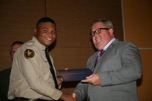 Jim Pledger (right), director of the Law enforcement Academy at GNTC, congratulates Tyler J. Ware (left) for graduating from GNTC's Law Enforcement Academy.