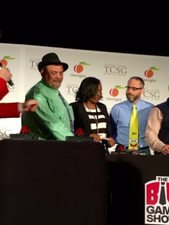 Brittny Burns, middle, competes in a Game Show night at the TCSG event in Atlanta, Georgia.