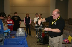 Tyler Gayan (right), instructor of Criminal Justice at GNTC, shows the Rockmart High School students fingerprinting techniques used by law enforcement professionals.