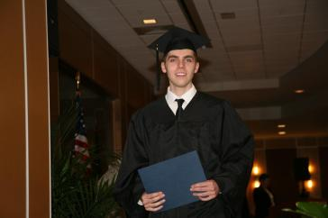 Chase Bailey celebrates after receiving his GED® diploma.