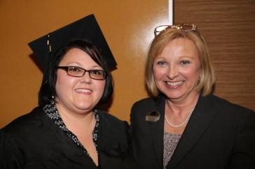 Brandy Weaver (left), winner of GNTC's 2016 EAGLE Award, poses with Connie Smith (right), vice president of Adult Education at GNTC, during GNTC's GED® Commencement Ceremony on Thursday, May 12. Weaver delivered the keynote address for the ceremony and was also a finalist for the State EAGLE Award for 2016.