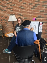 A Bobcat getting her caricature done during Spring Fling 2017 on the GCC!